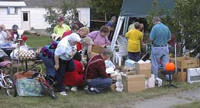 This Lake George garage sale was swarming with  buyers before it even had the boxes unpacked!