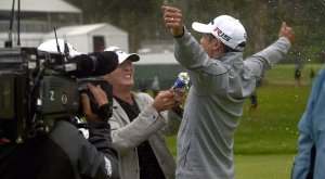 James Hahn, right, celebrates his breakthrough victory at the Northern Trust Open