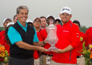 J.B. Holmes, 2015 Shell Houston Open winner, accepts the winner's trophy from Marvin Odum, President of Shell Oil Company. Holmes claimed his fourth PGA Tour victory in a playoff with 2008 SHO winner Johnson Wagner and World No. 4 Jordan Spieth.