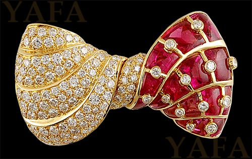 BVLGARI Vintage Diamond and Ruby Bow Brooch mounted in 18k yellow gold, signed Bvlgari.